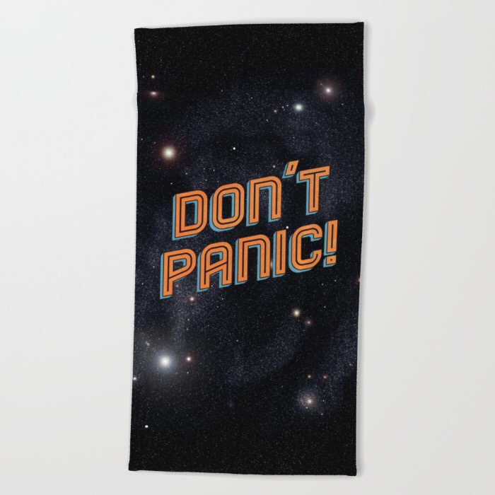 product photo of a beach towel with an image of space and the words DON'T PANIC in large, friendly letters